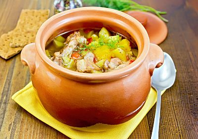 Clay pot with meal cooked in it