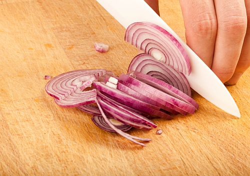 cutting onion with a ceramic knife